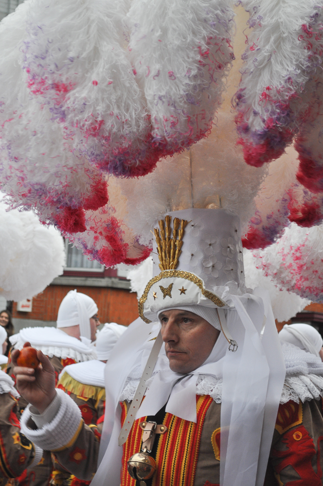 One of the Gilles in an ostrich feather hat at the Shrove Tuesday Carnaval parade in Binche, Belgium